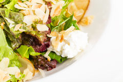 Pear salad with goat cheese and almonds. Stock Photo