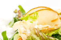 Pear salad with goat cheese and almonds. Royalty Free Stock Images