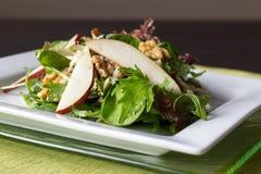 Pear salad. Healty pear and walnut salad Royalty Free Stock Photos