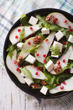 Pear salad with pomegranate and arugula close-up. vertical top v Royalty Free Stock Images
