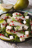 Pear salad with pomegranate, cheese and arugula close-up. Vertic Royalty Free Stock Photography