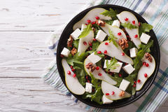 Pear salad with pomegranate, cheese and arugula. horizontal top Stock Photography