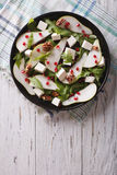 Pear salad with pomegranate, cheese and arugula. vertical top vi Royalty Free Stock Photo