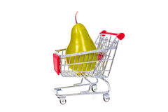 Pear in shopping cart isolated on white background Royalty Free Stock Images
