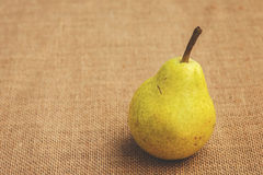 Pear sitting on a table Royalty Free Stock Photo