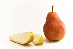 Pear with slices. One upright Pear fruit and two slices royalty free stock image