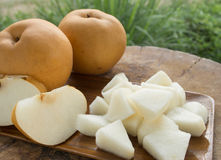 Pear. Slices on wooden tray Royalty Free Stock Images