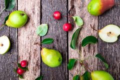 Pear and small apple on wooden rustic background. Top view. Frame. Autumn harvest. Royalty Free Stock Photo
