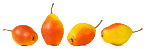 Pear standing and pears lying, group of yellow and red pears, isolated. Royalty Free Stock Photography