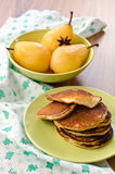 Pear stewed in citrus juice and pancakes Royalty Free Stock Photo