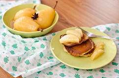 Pear stewed in citrus juice and pancakes Royalty Free Stock Images