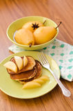 Pear stewed in citrus juice and pancakes Stock Image