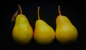 Pear. In the studio light with black background royalty free stock photos