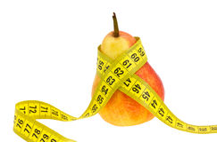 Pear with tape measure. Stock Images