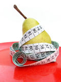 Pear with Tape Measure Concept Stock Images