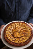 Pear tart in the man hands top view Stock Photography