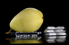 Pear on a tray and medicine Royalty Free Stock Photography