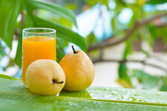 Pear tropic fruit summer refreshment smoothie Royalty Free Stock Images