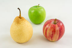 Pear and two apples on a white background. Fruit on the table on a white background Stock Photo