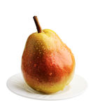 Pear on a white plate, isolated Royalty Free Stock Image