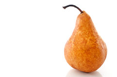 A pear on a white reflective surface Stock Image