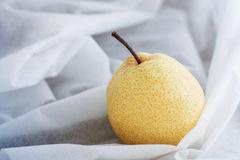 Pear on white tablecloth. Royalty Free Stock Photos