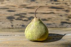 Pear on wood stock photography