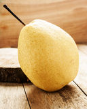 Pear on wooden background Royalty Free Stock Image