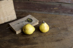Pear on a wooden background. Yellow pear on a wooden background royalty free stock image