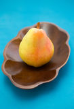 Pear in a wooden bowl Stock Photo