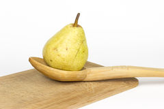 pear in a wooden spoon Royalty Free Stock Photos