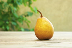 Pear on wooden table Royalty Free Stock Images