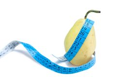 Pear wrapped around a measurement tape Stock Photography
