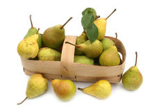 Pear yellow and green. Fruit of a pear yellow and green in a basket on a white background Stock Photos