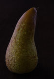 Pear. Yellow pear with water drops royalty free stock photography