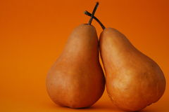 Peared Up. Two pears enjoying each others company royalty free stock photography