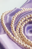 Pearl. Beads of pearl on the lilac Royalty Free Stock Photos