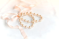 Pearl. Pink pearl necklace with lace.wedding gift from friend Stock Photography