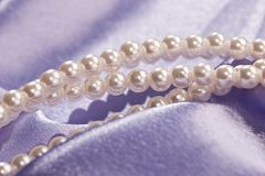 Pearl. Beads of pearl on the lilac for lady Royalty Free Stock Photography