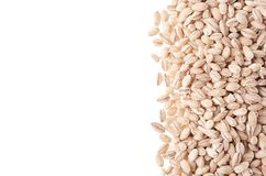 Pearl barley as decorative border isolated on white background. Top view, closeup. Royalty Free Stock Photography