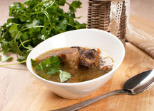 Pearl barley and beef with bone soup. Bowl Royalty Free Stock Images