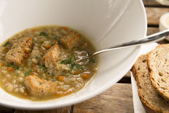 Pearl barley broth with ciabatta croutons Royalty Free Stock Photography