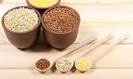 Pearl barley, buckwheat, millet groats Stock Images