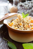 Pearl barley and carrots cooked in a pot Stock Image