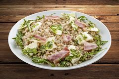 Pearl barley with ham and cheese. royalty free stock photos