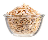 Pearl barley heap in small glass bowl Stock Image