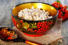 Pearl barley porridge in a colorful bowl. Stock Image