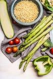 Pearl barley porridge or salad preparation with vegetables ingredients, top view. Healthy clean eating, vegan or vegetarian food Royalty Free Stock Images