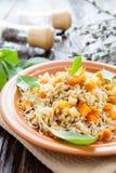Pearl barley porridge with vegetables Stock Image