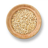 Pearl barley in wood plate Royalty Free Stock Photo
